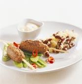 Kryddiga kebabspett med bönor och couscous